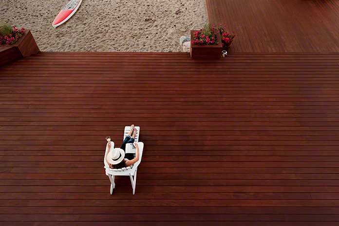 lifestyle shot, mahogany deck at a cottage with beach, cottage country, Ontario, advertising